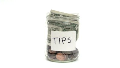 stock-footage-money-tips-jar-hd
