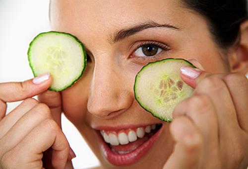 getty_rf_photo_of_woman_using_cucumbers_on_eyes
